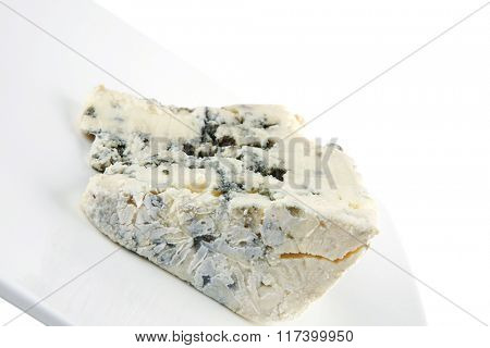 soft moldy stilton cheese on white dish