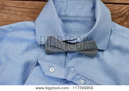 blue shirt with bow tie close-up