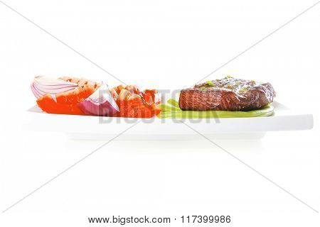 roast meat served with tomato on white dish