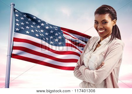 Smiling crestive business woman against usa national flag