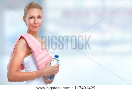 Young fitness woman with bottle of water.