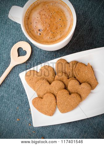 Cup of coffee and heart shaped cookies