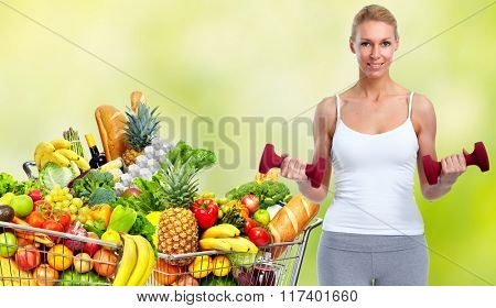 Grocery shopping cart with fruits