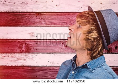 Side view of surprised hipster man against composite image of usa national flag