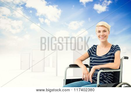 Smiling woman in a wheelchair against opening door in sky