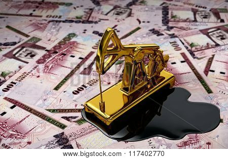 Gold Pumpjack And Spilled Oil Over Saudi Riyals