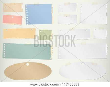 Pieces of torn colorful blank note paper with adhesive tape