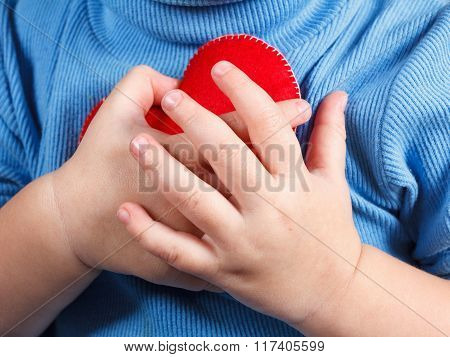 Hands Holding Baby Heart Symbol. Concept Of Love, Health And Care