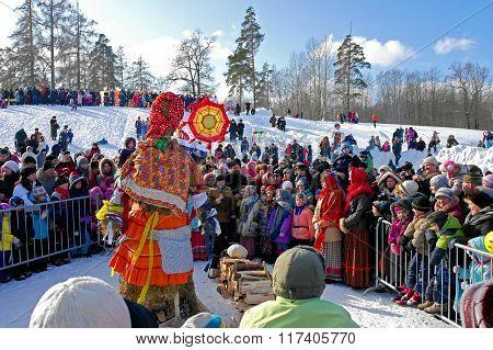 Gatchina, Leningrad region, RUSSIA - March 5, 2011: Maslenitsa. People around the doll.