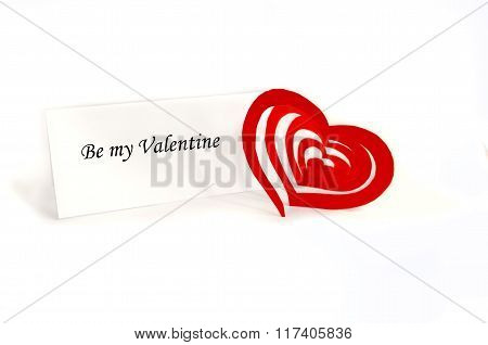 A Valentine Card And A Red Heart
