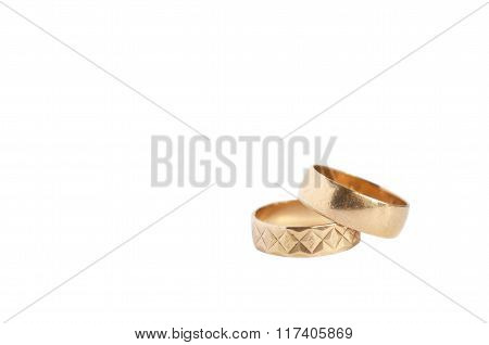 Two Gold Wedding Rings Isolated On White