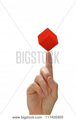 Woman's Hand With A Red Cube On The Finger