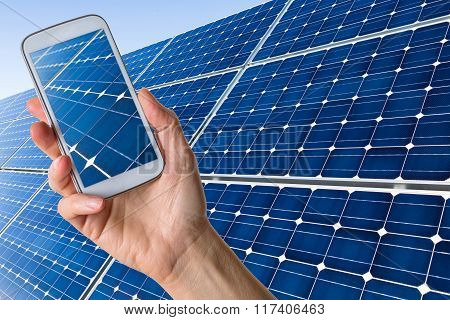 Smartphone In Hand Showing Solar Panels
