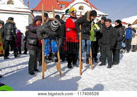 Gatchina, Leningrad region, RUSSIA - March 5, 2011: Maslenitsa. Competition - walking on stilts