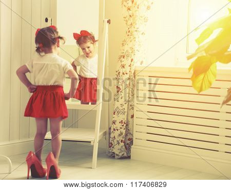 Little Girl Child Fashionista Looking In The Mirror At Home
