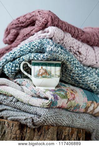 Mug Among Different  Knitwear.