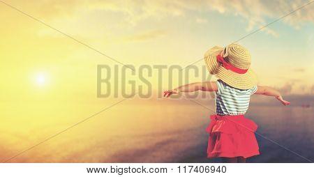 Happy Child Girl Admiring Sunset On Beach
