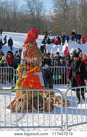 Gatchina, Leningrad region, RUSSIA - March 5, 2011: Making doll of Shrovetide before burning
