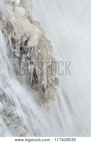Frozen waterfall in winter with beautiful icicles