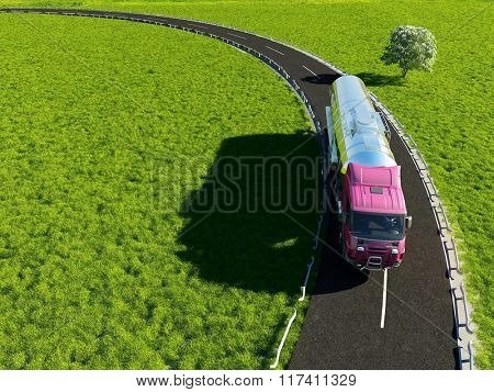 Lorry on the background of green field.