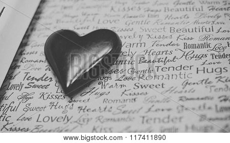 Chocolate Heart on Newspaper Texture