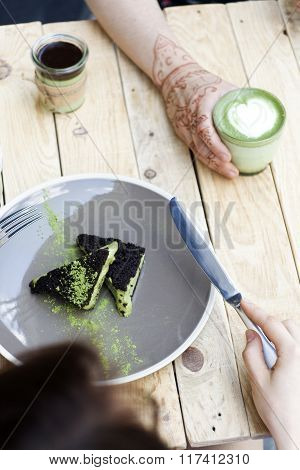 Cup Of Matcha Green Tea In Woman Hand And Cake And Ice Cream With Green Matcha