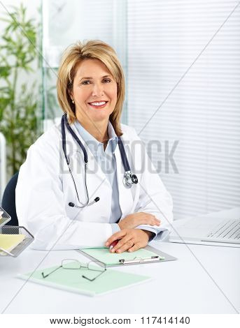 Mature doctor woman in a clinical office.