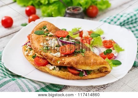 Omelet With Tomatoes, Parsley And Feta Cheese On White Plate.