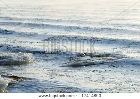 Frozen Sea View. Waves Hitting Icy Coastline