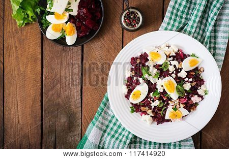 Salad Baked Beets, Feta Cheese, Eggs, And Walnuts. Top View