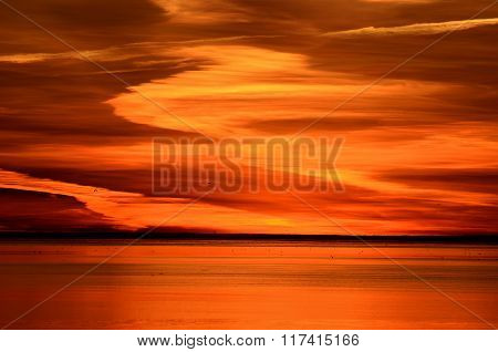Colourful orange Sunset In The open Sea