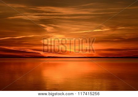 Colourful Orange Sunset In The Calm Sea