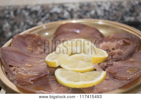 Smoked Tuna With Slices Of Lemon
