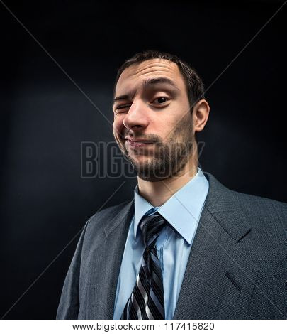 Businessman winking