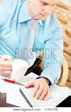 closeup of a businessman working with notebook