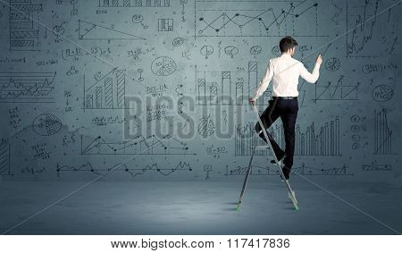 A businessman in modern stylish elegant suit standing on a small ladder and drawing pie and block charts on grey wall background with exponential progressing curves, lines, circles, angles, blocks
