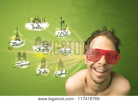 Happy young man with sunglasses traveling to cities around the world concept