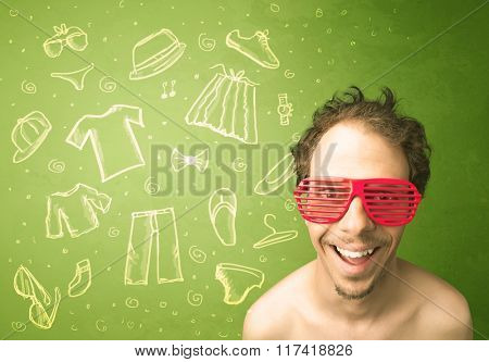 Happy young man with glasses and casual clothes icons concept on green background