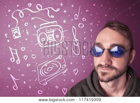 Happy funny guy with shades and hand drawn media icons concept on background