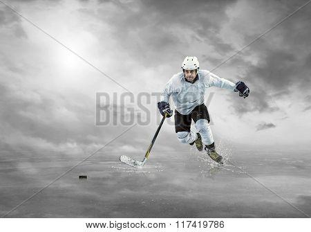 Ice hockey player on the ice under sky