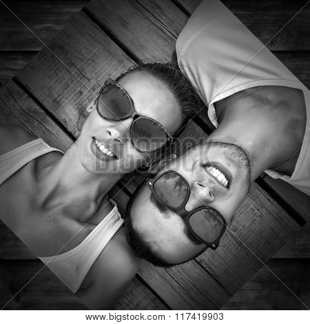 Portrait of couple on the wooden background.