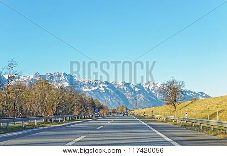View From Road On Snow Covered Swiss Mountains