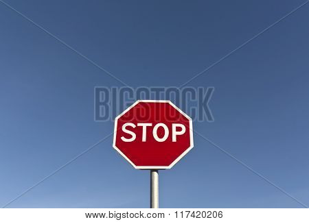 Red Stop Sign And Blue Sky.