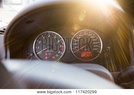 car dashboard in the sun rays