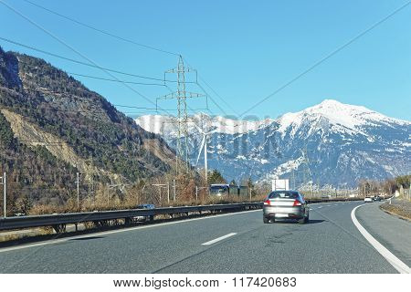 View Of Road With A Car In Switzerland In Winter