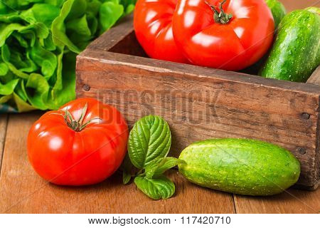 Cucumbers, Tomatoes And Butterhead Lettuce In Wooden Box