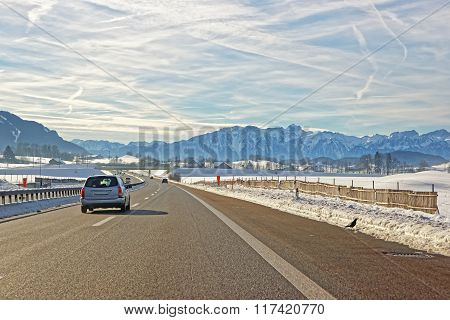 View Of Road With Car In Switzerland In Winter