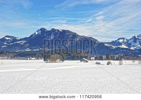 Landscape Of Snowy Countryside In Switzerland In Winter