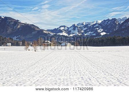 Landscape Of Countryside In Snowy Switzerland In Winter