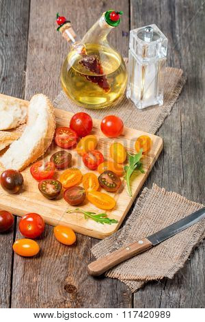 Fresh Colorful Tomatoes, Olive Oil And Bread